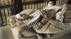 Tomb effigy of Elizabeth I. The large marble monument was by Maximilian Colt, assisted by John de Critz, and dates to early seventeenth century (during the reign of James I, Elizabeth's successor). The jewelry and regalia on the effigy are modern pieces, dating to the 1970s. The tomb, which cost 1,485 British £- is situated in Henry VII's Lady Chapel in Westminster Abbey.