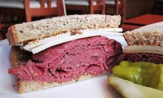 Pastrami & Swiss Sandwich with shaved New York style pastrami with Swiss cheese and whole grain mustard on caraway rye bread. Pastrami Sandwich, Sandwiches, Raw Bars, Rye Bread, Swiss Cheese, New York Style, Wine List, Seafood Restaurant, Mustard