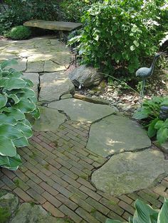 brick and stone together reminds me of European streets and old gardens. love love love paving patterns by KarlGercens.com, via Flickr.