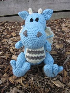 This is a PDF crochet pattern for a Dragon soft toy, written using UK crochet terminology. (US Version available here) It is 17 pages long with detailed instructions and photo tutorials for feet and wings.