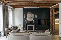 Un mur de couleur sublime ce grand salon