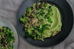 Super green salad with broccoli, kale and avocado sauce.