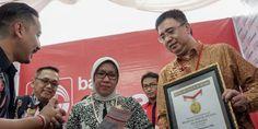 Dalam sosialisasi di Purwokerto tercatat rekor MURI pembeli reksa dana syariah. - Dream