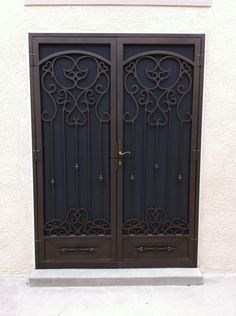 Ornamental Iron Security Doors With Two Pieces Of Doors To Get Value Good Design / Security Doors   Home Security Doors with Fantastic Decorations