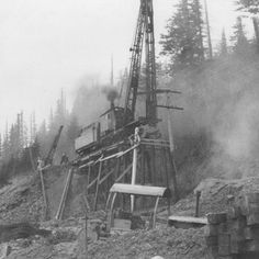 A pile driver builds a trestle during the construction of the Spokane, Portland & Seattle Railway
