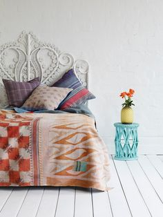 vintage wicker headboards, vintage sari pillows and throwkiknkkmkbmkjd