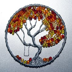 ~ Fall Colors Tree of Life pendant. 3 inches in diameter made with aluminum wire, red, orange, amber, and yellow seed beads. A swing hangs fr. Fall Colors Tree of Life pendant Wire Crafts, Jewelry Crafts, Jewelry Ideas, Wire Wrapped Jewelry, Wire Jewelry, Jewellery, Art Fil, Tree Of Life Jewelry, Tree Of Life Art