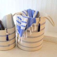 These stylish floor baskets are tall and come with long handles for easy carrying. They can be used to store a variety of things: laundry, blankets, towels, scatter cushions, etc. They can also be used in children's nurseries to store toys neatly.  Mia Mélange baskets are made from 100% cotton rope which we carefully sew together in a coiling technique. The cotton is grown locally in South Africa by farmers who are members of the Better Cotton Initiate (BCI). Rope Basket, Large Baskets, Scatter Cushions, Cotton Rope, Nurseries, Farmers, South Africa, Towels, Blankets