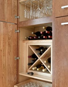 The Kraftmaid cabinet interiors are cleverly designed to maximize storage for glasses and wine bottles.