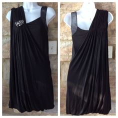 """NWT Miss Me Couture Dress Gorgeous black MM Couture dress with jeweled shoulder. Has beautiful draping detail with bubble hemline and the slim shoulder strap is sheer. Perfect for date night, special occasion or holiday party! Has excellent stretch & is super soft. Material is 95% Rayon & 5% spandex. In my opinion, this could also fit a medium, as the draping is very forgiving. . 35"""" in length from top of shoulder to hem. Super sexy & elegant! Miss Me Dresses"""