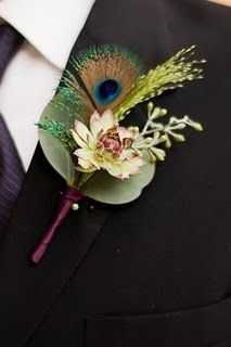 groomsmen; The Groomsmen each wore a boutonniere of living succulents, seeds from Seeded Eucalyptus, Fountain grass & peacock feathers. Their stems were treated in the same manor as the Groom's.