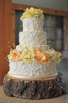 Sit a simple cake on a piece of wood for a rustic serving platter! #weddingcakes #popcake #food