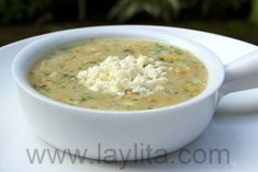 Repe Lojano or green banana soup - A creamy soup made with green bananas, onions, garlic, milk, cheese and cilantro. It is a traditional soup from the province of Loja, in Ecuador.