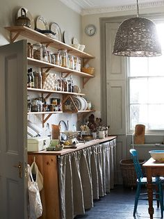 Kristin Perers', rustic, country kitchen sits elegantly within the Georgian, townhouse style interior architecture. She has such a good eye.