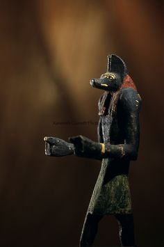 Wooden Anubis statue found at Ain el-Lebekha, Darb el-Arbaein, trade route, Anubis is the watcher of the road, Egypt; Archaeologist; Salima ...