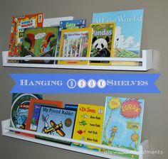 Hanging Wall Bookshelves using pegboard to hold rain gutter bookshelves=love (i would paint
