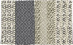 great texture and pattern in neutral colour palette for modern beachy/cottage feel in the great room