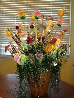 """I made this """"bouquet"""" of 21 airplane sized liquor bottles for my daughter's birthday. Liquor Bouquet, Liquor Bottles, 21st Birthday, To My Daughter, Airplane, Restaurant, Table Decorations, Girls, Plants"""