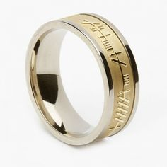 A Mens White Gold Irish Ring with Yellow gold  with Ogham script which means Mo Anam Cara - My Soul Mate. The script is an early form of old Irish writing. Available in 10k or 14k Gold.