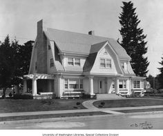 Two-story Colonial Revival house with gambrel roof, symmetrical facade and center entrance, probably Oregon, ca. - Society and Culture Collection - University of Washington Digital Collections Dutch Colonial Exterior, Dutch Colonial Homes, Gambrel Roof Trusses, Roof Styles, House Styles, Roof Truss Design, Usa House, Stone Houses, House Roof