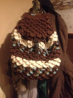 My first bag Brown and blue/brown variegated off white bag crocodile stitch crochet book bag style.
