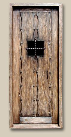 Exterior Door with Glass Pane Crafted with an antique Mexican door and custom grillwork. Features original antique clavos. 7601H Matthews