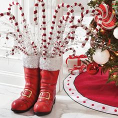 buy a pair of kid's boots at goodwill and spray paint!, also can be used for a planter outside