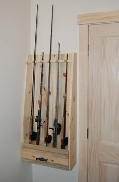 I thought this would be cool for your fishing poles!! Fishing Rod Rack Built of Beetle Killed Pine. $185.00, via Etsy.