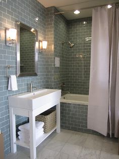 Sky Glass Subway Tile bathroom....really like the vaniety!