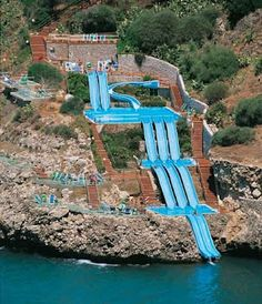 Città del Mare Hotel Village in Sicilia shows us how to take advantage of a stunning mountainside location with this incredible series of water-slides into the sea!