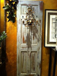 Old door with sconce added - how darling! Old Door Decor, Shutter Decor, Old Baskets, Old Doors, Antique Doors, Old Shutters, Old Windows, Painted Doors, Rustic Charm