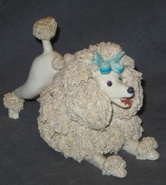 So Cute! This one wants to play. Vintage 1950s Spaghetti Poodle Dog Figurine with Blue Bow