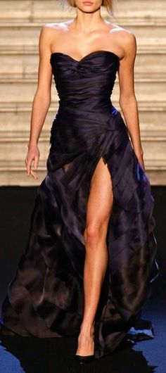 Valentin Yudashkin.  The color, fabric, and layering really add depth to this gorgeous gown.  Beautiful!