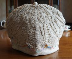 Shabby Chic Ivory Beige Cotton Weave Insulating Fabric Tea Cosy / Cozy with Vintage Doily Trim and Custom Pearly Polymer Clay Bead Pull Top by TeaWithFriends on Etsy $50.00 CAD