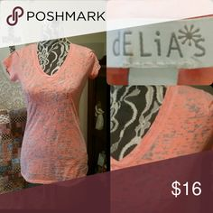 Cute Little Delia's Tee Color is mix between coral and pink....see through look...so cute! Size small! Delia's Tops