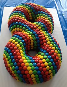 2 bundt cakes and a giant bag of candy coated chocolates made this colorful 8 cake for my son's birthday!