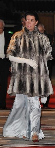 PRINCESS CAROLINE OF MONACO~ leaves a ball wearing a full let out chinchilla evening jacket.