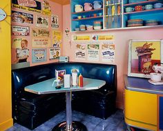 Retro diner style kitchen- love the corner booth and table style