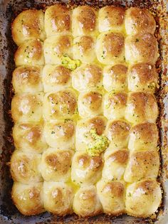 Jamie Oliver... Tear 'n' share garlic bread recipe. Soft, spongy and with the crunchiest backsides you've ever seen, as well as being bombed with pungent garlic butter – what's not to love?