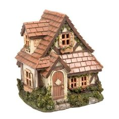 """description~ Make any fairy garden a cozy getaway with our charming fairy garden cottage house featuring two stories and a shingle roof. This resin house offers multiple four-pane windows, filled flower boxes, and a neatly trimmed yard full of lush greenery that fairies are accustom too.~ dimensions~ 6"""" Wide x 5.5"""" Dee"""
