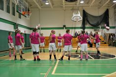 They all got shirts in pink for the game that were also donated