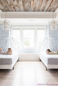 A whimsical bedroom reveal in our 1905 Historic Renovation! Featuring pendant lighting, decorative headboards, patterned wallpaper and light-wash flooring.