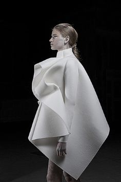 Best in Sculptural Fashion: Love the contrast between the huge exaggerated volumes  and the super minimalist monochromatic color palette.