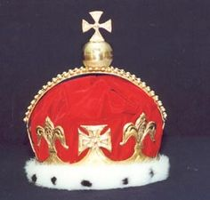 Prince Charles of Wales Crown -  Single arched crown of gold over a Cap of Estate, made in 1728 for Prince Frederick Louis, son of King George II, and father of George III. This crown was used when he took his seat in the House of Lords where it was placed on a cushion in front of him. It was used subsequently in the same fashion, lastly by King Edward VII when he was Prince of Wales. It has not been used since.