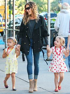 Sarah Jessica Parker's 4-year-old twin daughters, Tabitha and Loretta, show off their ladylike style Thursday while walking to school with Mom through New York's West Village.