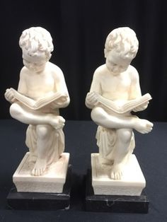 PAIR OF ITALIAN CRAFTED READING BOY BOOKENDS ON MARBLE BASES. THEY MEASURE 9 INCHES IN HEIGHT