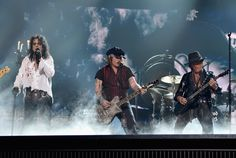 Johnny Depp Photos - (L-R) Singer Alice Cooper, actor/musician Johnny Depp and musician Joe Perry of Hollywood Vampires perform onstage during The 58th GRAMMY Awards at Staples Center on February 15, 2016 in Los Angeles, California. - The 58th GRAMMY Awards - Roaming Show