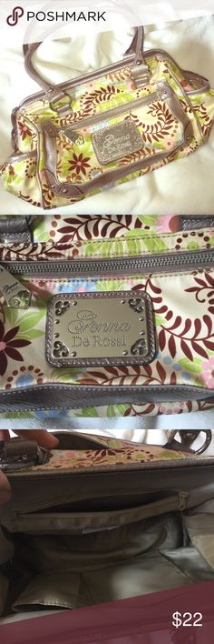 """Super fun Genna De Rossi hand bag. Genna De Rossi. Bottom measures 11.5"""" x 4 but rounds out to about 6"""". Shoulder straps cap at 11"""". Pockets on each end and on front and back. 3 pockets on the inside. One has a zipper. Super fun bag! Thanks for shopping Bags Shoulder Bags"""