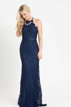 Hello gorgeous! As if the dark navy color alone wasn't enough to catch our eyes, the scalloped halter top and form fitting silhouette of this flattering maxi dress has us completely head over heels. T