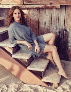 Julia Roberts flaunts her legs in a grey ribbed-knit sweater dress